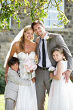 Bride And Groom With Bridesmaid And Page Boy At Wedding Stock Image
