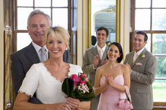 Bride and groom by bridesmaid and ushers clapping, smiling, portrait Royalty Free Stock Image