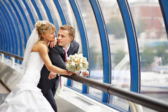 Bride and groom on Bridge Business Center Royalty Free Stock Photography