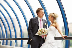 Bride and groom on Bridge Business Center Royalty Free Stock Image