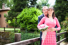 bride and groom on a bridge near a park Royalty Free Stock Photography