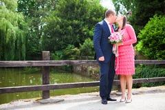 Bride and groom on a bridge near a park Stock Photos