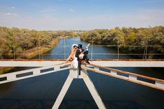 Bride and groom on the bridge over the river  Royalty Free Stock Image