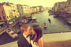 Bride and groom on a bridge in Venice Stock Image
