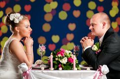 Bride and groom at cafe Royalty Free Stock Photos
