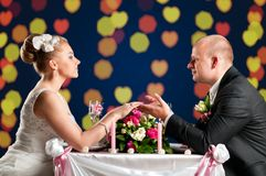 Bride and groom at cafe Royalty Free Stock Photography