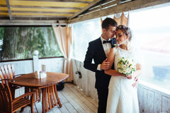 Bride and groom in the cafe an outdoor Royalty Free Stock Photo