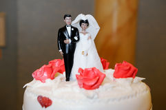 Bride and groom on cake Stock Photo