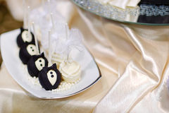 Bride and groom cake pops Stock Photos