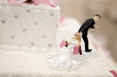 Bride and Groom cake toppers on a wedding cake Royalty Free Stock Photo