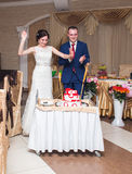 Bride And Groom With Cake  At wedding Reception Stock Photos