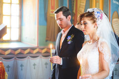Bride and Groom with Candles Stock Photography