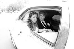 Bride and groom in a car. Bride and groom in the limousine royalty free stock image