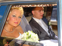The bride and groom in a car Stock Images