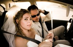 Bride and Groom in the Car Royalty Free Stock Photos