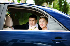 Bride and groom in the car stock photo