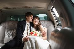Bride and groom in a car Stock Image