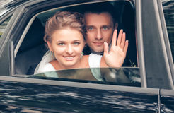 Bride and groom in the car Stock Photography
