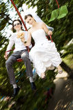 Bride and groom on carousel Stock Image