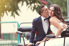 Bride and groom in a carriage Stock Photos