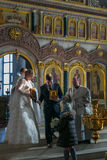 Bride and groom carry icons. MOSCOW - MARCH 10: bride and groom carry icons during orthodox wedding ceremony on March 10, 2013 in Moscow Royalty Free Stock Image