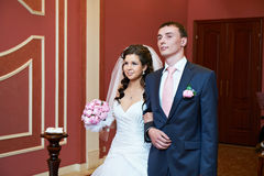 Bride and groom at ceremony of marriage registration Stock Photography