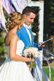 Bride and Groom with Certificate. Bride with bouquet and groom with certificate Stock Images