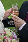 Bride and Groom with Champagne Stock Images
