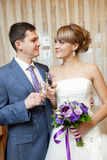 Bride and groom with champagne Stock Photography