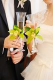 Bride and groom and champagne glasses Stock Image