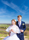 Bride and groom with champagne glasses in wedding day Stock Photography