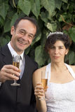 Bride and Groom With Champagne - Vertical Royalty Free Stock Image