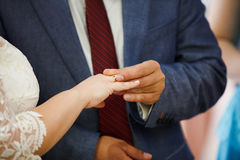 Bride and groom are changing rings Royalty Free Stock Photography