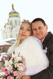 Bride and groom on church background Stock Images