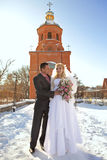 Bride and groom on church background Royalty Free Stock Photography