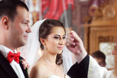 Bride and groom in church Stock Photos