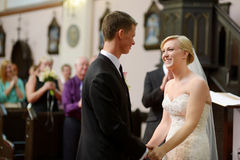 Bride and groom at the church. During a wedding ceremony Royalty Free Stock Photography
