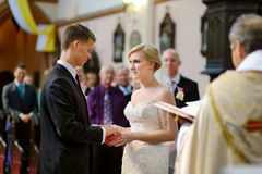 Bride and groom at the church Stock Photos