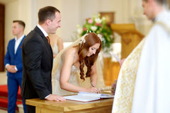 Bride and groom at the church during a wedding Royalty Free Stock Photos