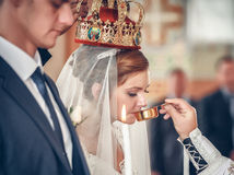 Bride and groom at the church during a wedding ceremony Royalty Free Stock Photo