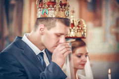 Bride and groom at the church during a wedding ceremony Stock Photo