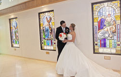 Bride and groom in church Stock Photography