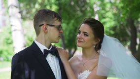 Bride and Groom in a City Park. Bride and Groom Looking at Each Other in a City Park. Wedding Day in Summer Time. Slow Motion. Family and Romantic Moments stock video