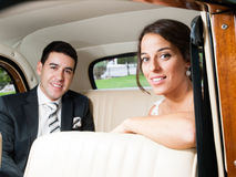 Bride and groom in a classic car Stock Image