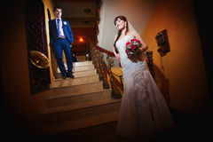 Bride and groom in the classic interior Royalty Free Stock Photography