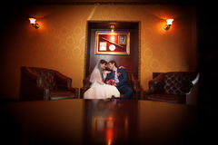 Bride and groom in the classic interior Stock Image