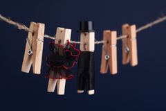 Bride and groom clothespin toys, clothesline. Abstract woman in flamenco red black dress  man with suit hat. Love. Bride and groom clothespin toys, clothesline Royalty Free Stock Photos