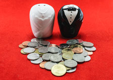 Bride and groom with coin for wedding cost concept Stock Photos