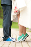 Bride and groom. In color gym shoe with lollipop Royalty Free Stock Images