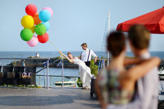 Bride and groom with colorful balloons Stock Images